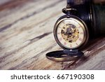 vintage pocket watch on wood... | Shutterstock . vector #667190308