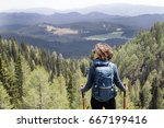 view at young woman hiking in... | Shutterstock . vector #667199416