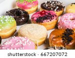 fresh assorted filled donuts in ... | Shutterstock . vector #667207072