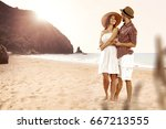 two lovers and summer time  | Shutterstock . vector #667213555