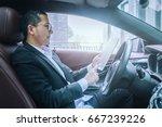 businessman sit in his car... | Shutterstock . vector #667239226