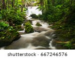 small waterfall in rainy season ... | Shutterstock . vector #667246576