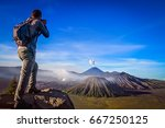 trekker taking photo of gunung... | Shutterstock . vector #667250125