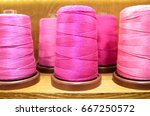 Close Up On A Pink Thread Spool