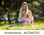 a young mother with her... | Shutterstock . vector #667260742