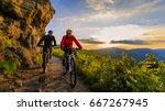 mountain biking women and man... | Shutterstock . vector #667267945