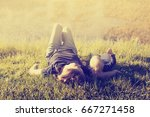 mother and baby relax on the... | Shutterstock . vector #667271458