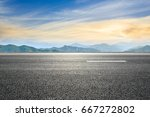 asphalt road and mountain... | Shutterstock . vector #667272802