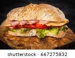 delicious ciabatta sandwich   Shutterstock . vector #667275832