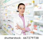 young female pharmacist at work.... | Shutterstock . vector #667279738