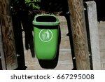 public green bin on the street... | Shutterstock . vector #667295008