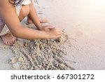 child hands play sand on the... | Shutterstock . vector #667301272
