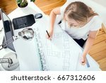 top view at architect's desk... | Shutterstock . vector #667312606