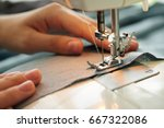 close up image of tailor sewing ... | Shutterstock . vector #667322086