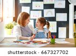 mother and child daughter draws ... | Shutterstock . vector #667327702