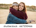 Two Smiling Female Friends...