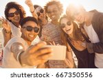 group of multiracial happy... | Shutterstock . vector #667350556