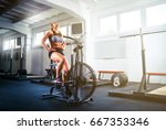 woman at the gym using exercise ... | Shutterstock . vector #667353346