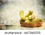 pickled green gherkins  | Shutterstock . vector #667360255