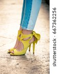 woman legs in leather yellow ... | Shutterstock . vector #667362256