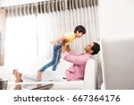 happy indian father playing... | Shutterstock . vector #667364176