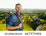 happy middle aged man hiking... | Shutterstock . vector #667374406