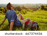 middle aged man relaxing and... | Shutterstock . vector #667374436