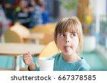 cute blonde girl sticking or... | Shutterstock . vector #667378585