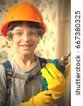smiling boy in a construction... | Shutterstock . vector #667380325