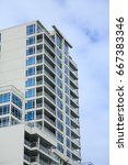 white condos with blue terraces ... | Shutterstock . vector #667383346