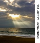 Small photo of Light breaking through the clouds at the beach in Biarritz, Fran