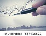 financial graphs analysis.... | Shutterstock . vector #667416622