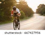 young man cyclist riding a bike ... | Shutterstock . vector #667427956