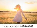 beautiful young lady walking in ... | Shutterstock . vector #667446142