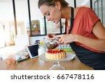 blogger taking picture of cake... | Shutterstock . vector #667478116
