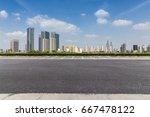 empty urban road with skyline ...   Shutterstock . vector #667478122