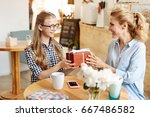 happy daughter receiving a... | Shutterstock . vector #667486582