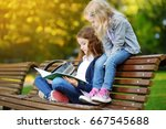 adorable little schoolgirls... | Shutterstock . vector #667545688