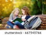 adorable little schoolgirls... | Shutterstock . vector #667545766