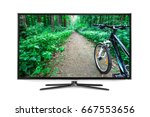 4k monitor isolated on white | Shutterstock . vector #667553656