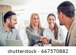 business team of four plan work ... | Shutterstock . vector #667570882