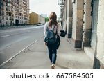back view of a hipster girl... | Shutterstock . vector #667584505