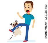 dog attacking young scared man... | Shutterstock .eps vector #667601452