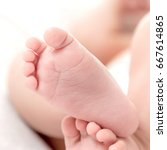 small legs of the baby on a... | Shutterstock . vector #667614865