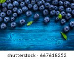 fresh blueberry with drops of... | Shutterstock . vector #667618252