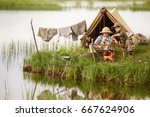 two boys set up camp  and... | Shutterstock . vector #667624906
