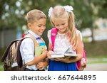 schoolboy and schoolgirl... | Shutterstock . vector #667644895