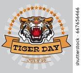 international tiger day emblem... | Shutterstock .eps vector #667656466