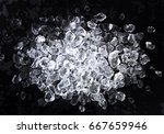 crushed ice on black background.... | Shutterstock . vector #667659946