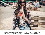 happy stylish hipster woman in... | Shutterstock . vector #667665826